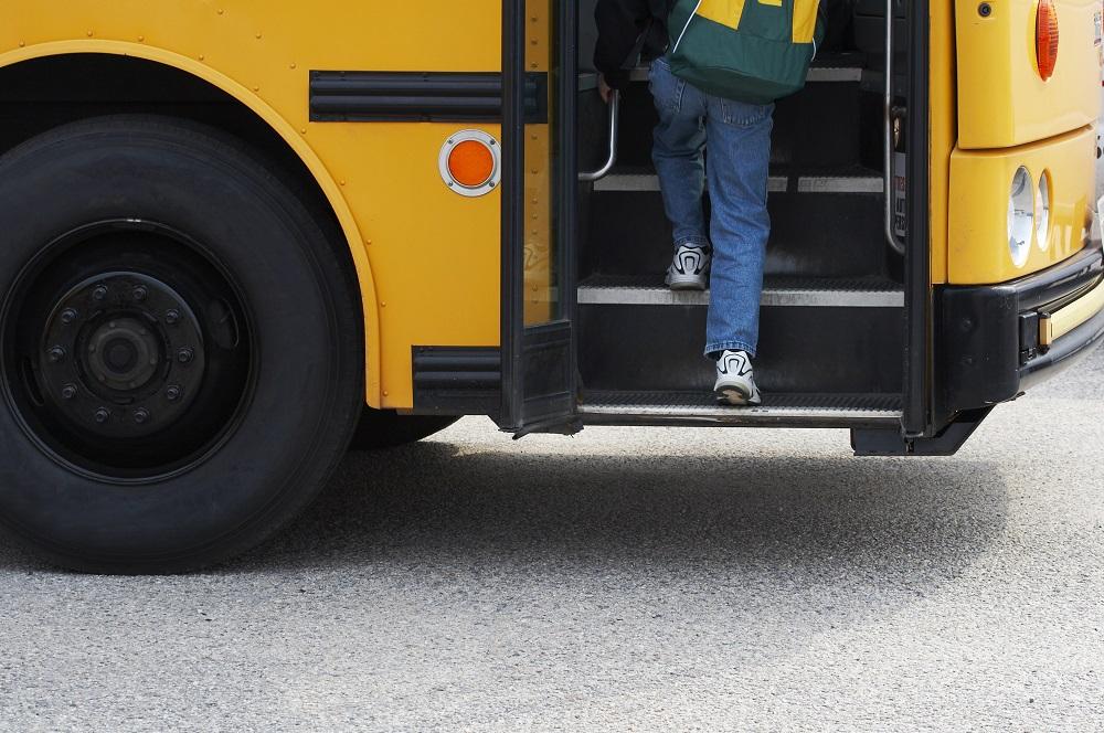 Kid Boarding a Bus